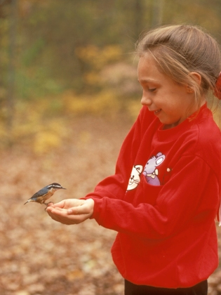 Girl with Black-Capped Chickadee in Hand